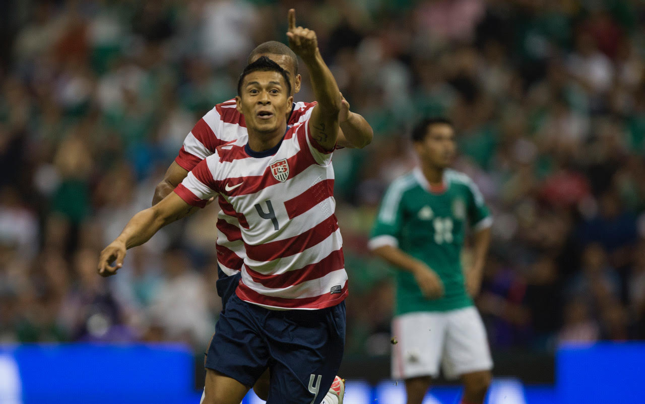 MEXICO CITY, MEXICO - AUGUST 15:  of Mexico fights for the ball with  of the United States during a FIFA friendly match between Mexico and US at Azteca Stadium on August 15, 2012 in Mexico City, Mexico. (Photo by Miguel Tovar/Getty Images) *** Local Caption *** nombers; nombers
